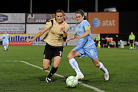 Heather O'Reilly (9) of Sky Blue FC is defended by Leigh Ann Robinson (7) of FC Gold Pride. Sky Blue FC and FC Gold Pride played to a 1-1 tie during a Women's Professional Soccer match at TD Bank Ballpark in Bridgewater, NJ, on April 11, 2009.