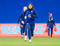 LE HAVRE, FRANCE - APRIL 13: Alex Morgan #13 of the USWNT warms up before a game between France and USWNT at Stade Oceane on April 13, 2021 in Le Havre, France.