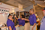 As part of the H.E.A.R.T. partnership with HISD, 17 high school students with disabilities are working and learning on the job at the Houston Food Bank. The students explain how to make sure there is plenty of iced tea for customers.