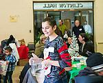 Waterbury, CT- 25 December 2016-122516CM06- Volunteer Sophia Gaspard of Waterbury helps serve guests during a Joy of Christmas Dinner at the First Congregational Church in Waterbury.     Christopher Massa Republican-American