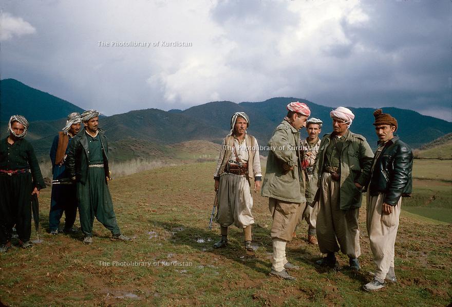 Iraq 1965     <br /> A peshmerga commander discussing with villagers during the armed struggle.  <br /> Irak 1965 <br /> Discussion dans un village avec les habitants et des responsables de peshmergas pendant la lutte armee