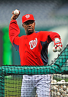 2 April 2011: Washington Nationals third base coach Bo Porter tosses batting practice prior to a game against the visiting Atlanta Braves at Nationals Park in Washington, District of Columbia. The Nationals defeated the Braves 6-3 in the second game of their season opening series. Mandatory Credit: Ed Wolfstein Photo