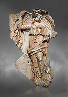Roman Sebasteion relief sculpture of the goddess Herma (day), Aphrodisias Museum, Aphrodisias, Turkey.  Against a grey background.<br /> <br /> Goddess  Herma or Day steadies a dramatically billowing cloak that frames her head. The motif , also visible on the Okeanos relief, indicates flying, floating and divine epiphany - the appearance of gods to mortals. Day would be paired with night : together they signify the eternity of the Roman imperial order.