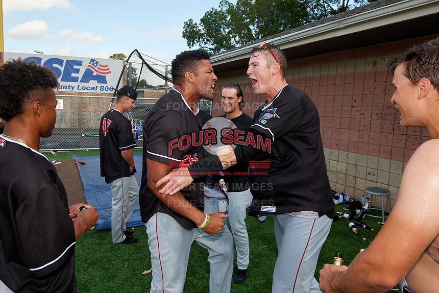 Batavia Muckdogs Lorenzo Hampton and Sean Reynolds celebrate after clinching the Pinckney Division Title during a NY-Penn League game against the Auburn Doubledays on September 2, 2019 at Falcon Park in Auburn, New York.  Batavia defeated Auburn 7-0 to clinch the Pinckney Division Title.  (Mike Janes/Four Seam Images)
