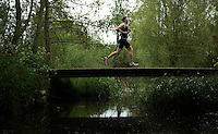 10 MAY 2015 - ST. NEOTS, GBR - Jonathan Hall, racing in the men's 25-29 category, crosses a bridge during the 2015 British Sprint Triathlon Championships at Riverside Park in St. Neots, Great Britain (PHOTO COPYRIGHT © 2015 NIGEL FARROW, ALL RIGHTS RESERVED)