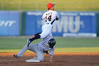 Tennessee Smokies shortstop Jonathan Mota #14 jumps over a hard sliding Ryan Curry to complete a double play during  a  game  against the Jacksonville Suns at Smokies Park on August 12, 2011 in Kodak, Tennessee. Tennessee won the game 5-4.   (Tony Farlow/Four Seam Images)