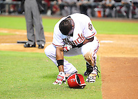 Jun. 21, 2010; Phoenix, AZ, USA; Arizona Diamondbacks outfielder Justin Upton reacts after being hit by a pitch against the New York Yankees at Chase Field. The Diamondbacks defeated the Yankees 10-4. Mandatory Credit: Mark J. Rebilas-