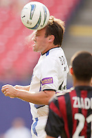 Sweat flies as the Earthquake's Chris Brown heads a ball as the MetroStars' Craig Ziadie watches. The San Jose Earthquakes were shut out by  the NY/NJ MetroStars 2-0 at Giant's Stadium, East Rutherford, NJ, on July 10, 2004.