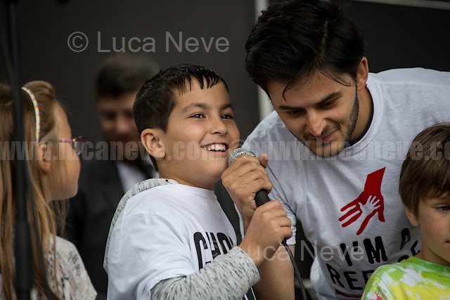 """(Center) Ahmad Sadoor (7-year-old Afghan Refugee; he saved the lives of 14 refugees trapped in the refrigerated back of a lorry trying to reach the UK).<br /> <br /> London, 17/09/2016. Today, an estimated 20,000 people gathered in Park Lane to attend the """"Refugees Welcome Here March"""" organised by """"Solidarity with Refugees"""". The peacefull demonstration ended with a rally in Parliament Square. From the organiser press release: << Last September, the image of 3 year old Aylan Kurdi's body on a Turkish beach horrified the world. 100,000 of us marched in London in response to tell our government that we want to welcome refugees in the UK, and to stop the drowning. Since then, thousands more terrified and desperate refugees, including hundreds of children, have lost their lives trying to reach safety in Europe. This September, world leaders will meet to discuss the refugee crisis at two crucial summits. This is the biggest opportunity of 2016 to show our government and the world that Britain is ready to welcome more refugees. Many British people have responded to the tragedy they see unfolding on their doorstep with extraordinary displays of humanity and generosity. They've been moved to act after seeing many thousands trapped in camps in Greece without running water or baby formula; thousands of people drowning in the Mediterranean as refugees seek increasingly dangerous routes to safety since the closing of borders and the sea route from Turkey; the continuing misery of the camp in Calais; the injustices and inefficiencies of Britain's own asylum system. 80% of Britons want our government to do more to help. Polls now show that 1 in 4 of us would welcome a refugee in our own home. We want to tell the government that we are waiting to help. The UK should be leading the way and working with other states to give refugees safe, legal routes to asylum, ending the trade in people smuggling […]>>.<br /> <br /> For more information please click here: http://bit.ly/29JPwRE & ht"""