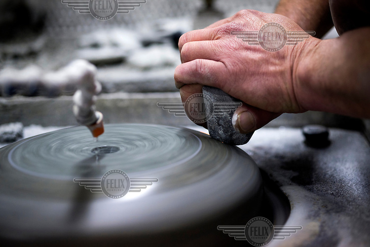 A curling stone, made from Ailsa Craig granite, being polished at Kay's in Mauchline, Faslane. The company uses the same rock to make the stones that will be used at the Sochi Olympic Games.