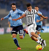 Calcio, Serie A: Lazio vs Juventus. Roma, stadio Olimpico, 4 dicembre 2015.<br /> Juventus' Paulo Dybala, right,is chased by Lazio's Santiago Gentiletti during the Italian Serie A football match between Lazio and Juventus at Rome's Olympic stadium, 4 December 2015.<br /> UPDATE IMAGES PRESS/Riccardo De Luca