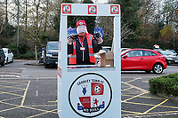 Programme seller ahead of Crawley Town vs Barrow, Sky Bet EFL League 2 Football at Broadfield Stadium on 12th December 2020