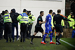 08.03.2019 Hibs v Rangers: Hibs fan is led away after attempting to get to James Tavernier at the half time whistle
