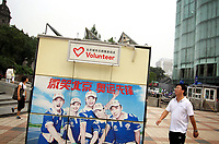 CHINA. An olympic volunteer station in central Beijing. The rise in use of English in China is evident on the streets of Beijing where store-fronts, billboards and clothes all sport English words and phrases. 2009