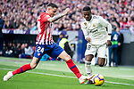 Jose Maria Gimenez of Atletico de Madrid and Vinicius Jr of Real Madrid during La Liga match between Atletico de Madrid and Real Madrid at Wanda Metropolitano in Madrid Spain. February 09, 2018. (ALTERPHOTOS/Borja B.Hojas)