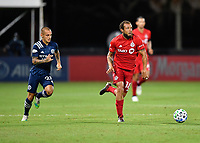 LAKE BUENA VISTA, FL - JULY 26: Nick DeLeon of Toronto FC dribbles away from Alexandru Mitrita of New York City FC during a game between New York City FC and Toronto FC at ESPN Wide World of Sports on July 26, 2020 in Lake Buena Vista, Florida.