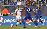 Foxborough, Massachusetts - July 30, 2014: First half action. In a Major League Soccer (MLS) match, the New England Revolution (white) vs Colorado Rapids (blue), 1-0 (halftime), at Gillette Stadium.