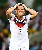 Bastian Schweinsteiger of Germany shows a look of dejection