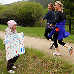 DEADWOOD, SD - JUNE 7, 2009 :  Ten year-old Lexi Zoellner waits with a sign for her dad and her uncle running during the Deadwood Mickelson Trail Marathon and half-marathon Sunday. (Photo by Dick Carlson/Inertia)