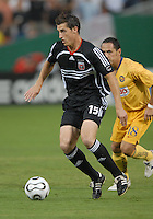 DC United forward Rod Dyachenko (15) controls the ball while being covered from behind by Club America midfielder German Villa (18), DC United defeated Club America 1-0 to secure one of the two semifinal berths in SuperLiga group B, at RFK Stadium in Washington DC, Sunday July 29, 2007.