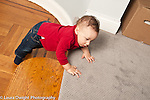 9 month old baby boy crawling up stairs from sunken living room