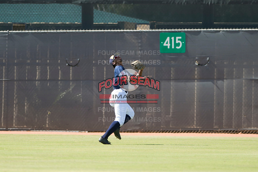 Milwaukee Brewers center fielder Joe Gray (9) pursues a fly ball during an Instructional League game against the Los Angeles Dodgers at Maryvale Baseball Park on September 24, 2018 in Phoenix, Arizona. (Zachary Lucy/Four Seam Images)