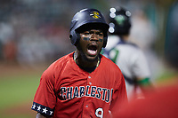 Osleivis Basabe (9) of the Charleston RiverDogs reacts after scoring a run during the game against the Augusta GreenJackets at Joseph P. Riley, Jr. Park on June 25, 2021 in Charleston, South Carolina. (Brian Westerholt/Four Seam Images)
