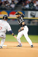 August 7, 2009: Shortstop Alexei Ramirez (10) of the Chicago White Sox turns a double play as Shin-Soo Choo slides in during a game vs. the Cleveland Indians at U.S. Cellular Field in Chicago, IL.  The Indians defeated the White Sox 6-2.  Photo By Mike Janes/Four Seam Images