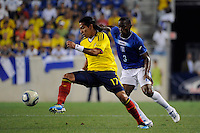 Dayro Moreno (17) of Colombia plays the ball in front of Maynor Figueroa (3) of Honduras during an international friendly between the men's national teams of Colombia (COL) and Honduras (HON) at Red Bull Arena in Harrison, NJ, on September 03, 2011.