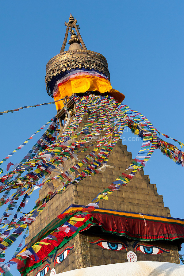 Bodhnath, Nepal.  The All-Seeing Eyes of the Buddha Gaze out from above the Stupa of Bodhnath, a center of Tibetan Buddhism, near Kathmandu.  Above the square base, the rising pyramidal levels represent the stages of perfection on the way to nirvana.
