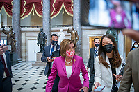 Speaker of the United States House of Representatives Nancy Pelosi (Democrat of California) is surrounded by reporters and photographers as she passes through Statuary Hall for a bill enrollment photo op for H.R. 1652 - VOCA Fix to Sustain the Crime Victims Fund Act of 2021, at the US Capitol, in Washington, DC, Wednesday, July 21, 2021. Credit: Rod Lamkey / CNP /MediaPunch