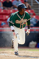 Rand Smith #21 of the Greensboro Grasshoppers hustles down the first base line against the Hickory Crawdads at  L.P. Frans Stadium July 10, 2010, in Hickory, North Carolina.  Photo by Brian Westerholt / Four Seam Images