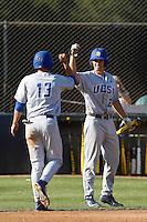 Joey Epperson #23 of the UC Santa Barbara Gauchos welcomes teammate Ryan Clark #13 during a game against the Cal State Northridge Matadors at Matador Field on May 10, 2013 in Northridge, California. UC Santa Barbara defeated Cal State Northridge, 6-1. (Larry Goren/Four Seam Images)