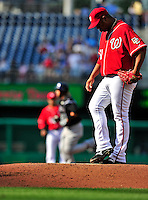 22 April 2010: Washington Nationals' starting pitcher Livan Hernandez looks down at the dirt on the mound as Miguel Olivo rounds the bases after tagging Hernandez for a solo home run during a game against the Colorado Rockies at Nationals Park in Washington, DC. The Rockies shut out the Nationals 2-0 gaining a 2-2 series split. Mandatory Credit: Ed Wolfstein Photo