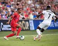 KANSAS CITY, KS - JUNE 26: Reggie Cannon #14 is challenged by Jose Rodriguez #7 during a game between Panama and USMNT at Children's Mercy Park on June 26, 2019 in Kansas City, Kansas.