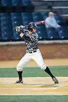 Drew Freedman (5) of the Wake Forest Demon Deacons at bat against the Miami Hurricanes at Wake Forest Baseball Park on March 20, 2015 in Winston-Salem, North Carolina.  The Hurricanes defeated the Demon Deacons 15-2.  (Brian Westerholt/Four Seam Images)