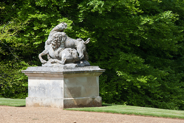 Lion and Horse sculpture by Peter Scheermakers (1740) at the end of the main lawn or Bowling Green (1720), Rousham House.