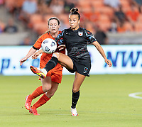 HOUSTON, TX - SEPTEMBER 10: Mallory Pugh #9 of the Chicago Red Stars clears the ball in front of Allysha Chapman #2 of the Houston Dash during a game between Chicago Red Stars and Houston Dash at BBVA Stadium on September 10, 2021 in Houston, Texas.