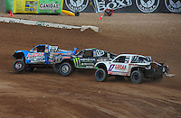 Mar. 20, 2011; Chandler, AZ, USA;  LOORRS pro two driver Robby Woods (99) leads Marty Hart (15) and Carl Renezeder (17) during round two at Firebird International Raceway. Mandatory Credit: Mark J. Rebilas-