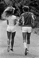 Farrah Fawcett and husband Lee Majors jog near their home in Los Angeles, May 1977. Photo by John G. Zimmerman.