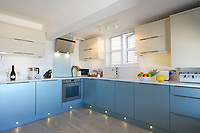 BNPS.co.uk (01202) 558833. <br /> Pic: KnightFrank/BNPS<br /> <br /> Pictured: Kitchen. <br /> <br /> The ultimate room with a view...<br /> <br /> A former fish cellar that is now an idyllic waterfront home overlooking a famous Cornish beach is on the market for £930,000.<br /> <br /> The ground floor apartment is in a prime frontline position with exceptional panoramic views over Porthmeor Beach and out to sea.<br /> <br /> Estate agent Christopher Bailey said the window in the reception space is like having your own live television screen looking out on the action of the beach.<br /> <br /> It has been designed and renovated to an exceptionally high standard and the immaculate flat is currently rented out for short holiday let, making about £40,000 profit a year.