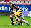 Pars' Andrew Geggan reacts to East Fife's Lewis Barr's late challenge from behind.