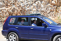 Pictured: Emergency services and pathologist Nikos Karakoukis (R) near the scene in Ikaria, Greece. Thursday 08 August 2019<br /> Re: Rescuers searching for  British scientist Natalie Christopher, 35, who disappeared on the  island of Ikaria, Greece have found her body at the bottom of a ravine.<br /> She was found less than a mile from the hotel in the Kerame area where she was on holiday with her Cypriot partner.<br /> Emergency service staff said that a large rock had dislodged as she fell, causing multiple head injuries.<br /> The woman's body will be kept overnight at the spot so a coroner can examine it on Thursday morning.