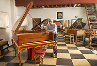 BNPS.co.uk (01202) 558833<br /> Pic: ZacharyCulpin/BNPS<br /> <br /> A remarkable collection of rare pianos belonging to the Queen's personal restorer and conservator has emerged for sale for £250,000.<br /> <br /> David Winston is parting with 26 pianos he has amassed over the past 30 years dating from the 18th century to the present day.<br /> <br /> Mr Winston, who was awarded the Royal Warrant in 2012, is regarded as one of the foremost experts in his field and has restored pianos owned and played by Beethoven, Chopin and Liszt.<br /> <br /> His collection includes a 1925 Pleyel grand piano fitted with an original 'Auto Pleyela' self-playing mechanism in a spectacular Chinoiserie Louis XV case valued at 60,000.