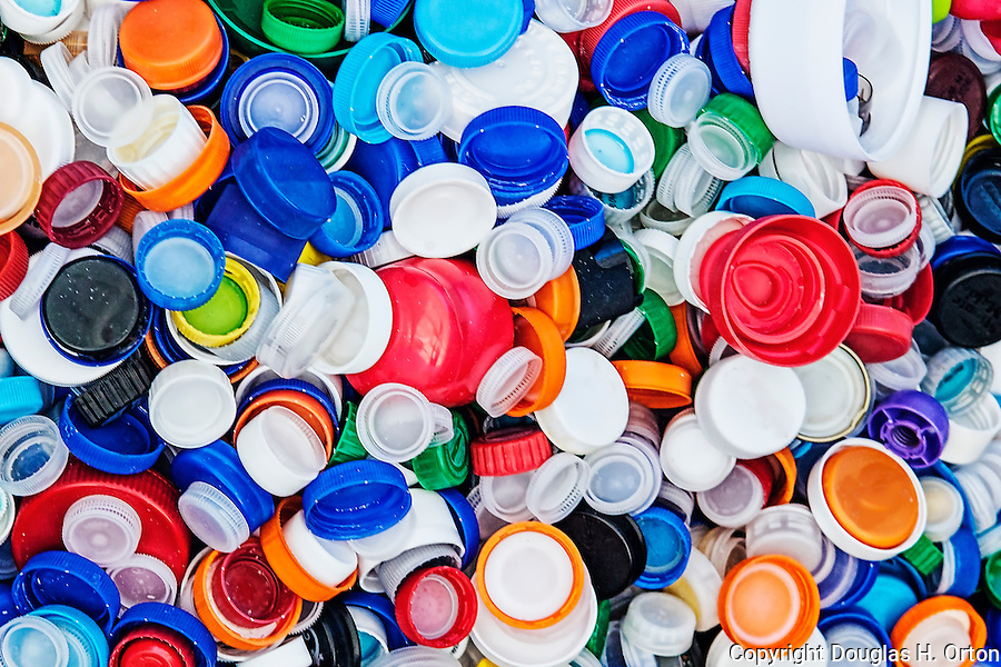 Bottle Caps in Recycle Bin.  Bottle caps are difficult to recycle but can be collected and properly sent for reuse.