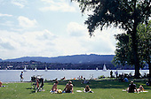 Zurich, Switzerland. People resting by the Lake Zurich; sailing.