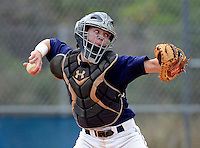 University Cougars catcher Patrick Stephens #20 throws down to second during a varsity baseball game against the Boone Bears at University High School on February 20, 2013 in Orlando, Florida.  Stephens is a junior prospect as a pitcher and catcher.  (Mike Janes/Four Seam Images)