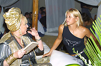 "Miami Beach, FL 8-9-2001<br /> Anna Kournikova consults with<br /> ""Mamma Love, a Numerologist<br /> and Psychic Healer, and Consultant<br /> to World Famous Celebrities"", at BED.<br /> Photo by Adam Scull/PHOTOlink"
