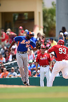 New York Mets infielder Brandon Allen (30) tags Jonathan Rodriguez (93) after at throw took him off the bag during a Spring Training game against the St. Louis Cardinals on April 2, 2015 at Roger Dean Stadium in Jupiter, Florida.  The game ended in a 0-0 tie.  (Mike Janes/Four Seam Images)