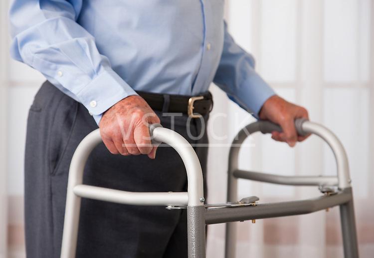 USA, Illinois, Metamora, Senior man walking with walker, mid section